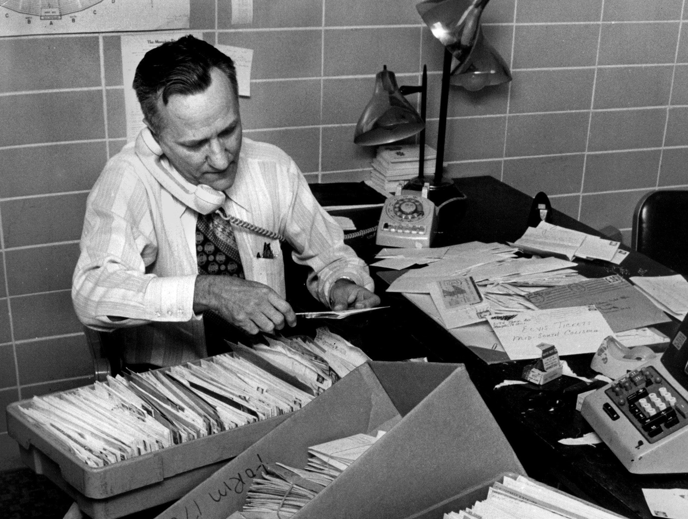 Mid-South Coliseum ticket office manager, Harry Brewer, sorts through mail order requests in Jan 1974 for tickets to three Elvis Presley concerts on March 16 and 17.  Coliseum manager E.E. Bland said that 4,000 requests were received during the day and that the concerts are expected to sell out in a hurry. Tickets cost $5 and $10.