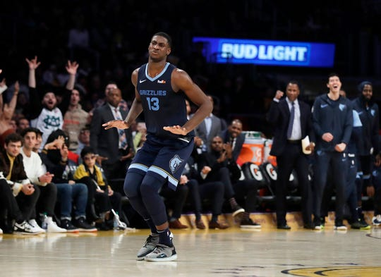 Memphis Grizzlies' Jaren Jackson Jr. (13) reacts after making a 3-point basket against the Los Angeles Lakers during the second half of an NBA basketball game, Sunday, Dec. 23, 2018, in Los Angeles. (AP Photo/Marcio Jose Sanchez)