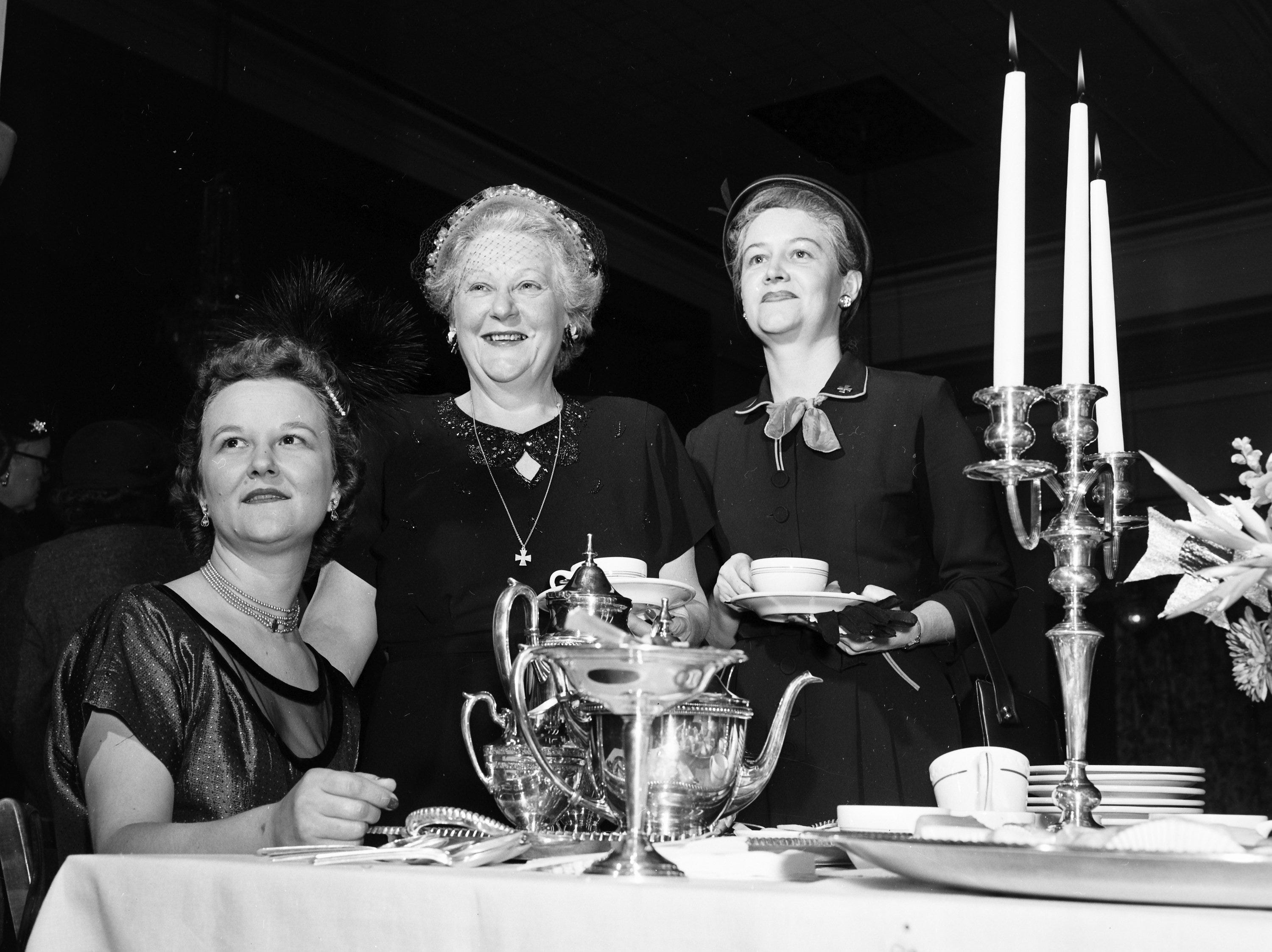 Among the 300 members of The King's Daughters who attended a tea given by the Memphis Union of The King's Daughters in January 1952 were (Left to Right) Mrs. Francis M. Brewer, leader of the Beata Circle; Mrs. Garner Strickland, state president, and Mrs. Kenneth Rhineberger, first vice president of the City Union.  The party took place at the Nineteenth Century Club with members of the Beata Circle serving as hostesses.
