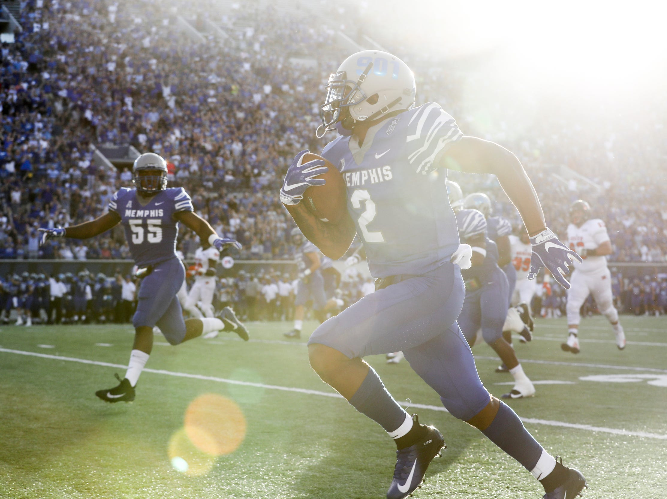 September 01 2018 - Memphis Tigers' TJ Carter runs in for a touchdown during Saturday's game versus Mercer at the Liberty Bowl Memorial Stadium.