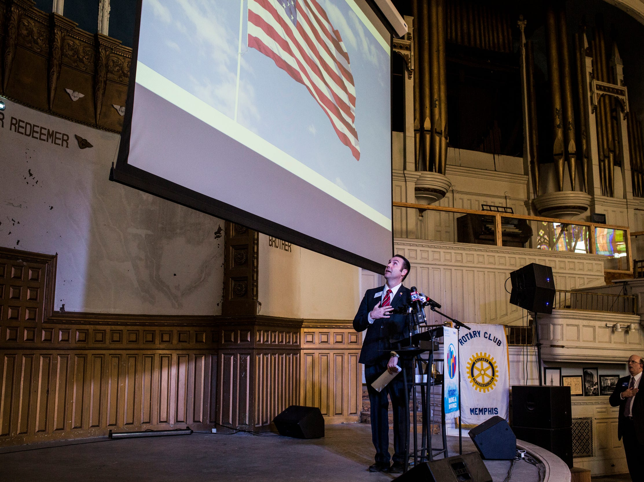 February 06, 2018 - Rotarian Cary Vaughn leads the Pledge of Allegiance before Shelby County Mayor Mark Luttrell delivered the State of the County address at the Rotary Club luncheon in Clayborn Temple.