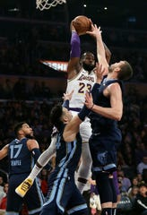 Los Angeles Lakers' LeBron James (23) passes as Memphis Grizzlies' Marc Gasol, right, and Dillon Brooks, bottom center, defend during the first half of an NBA basketball game Sunday, Dec. 23, 2018, in Los Angeles. (AP Photo/Marcio Jose Sanchez)