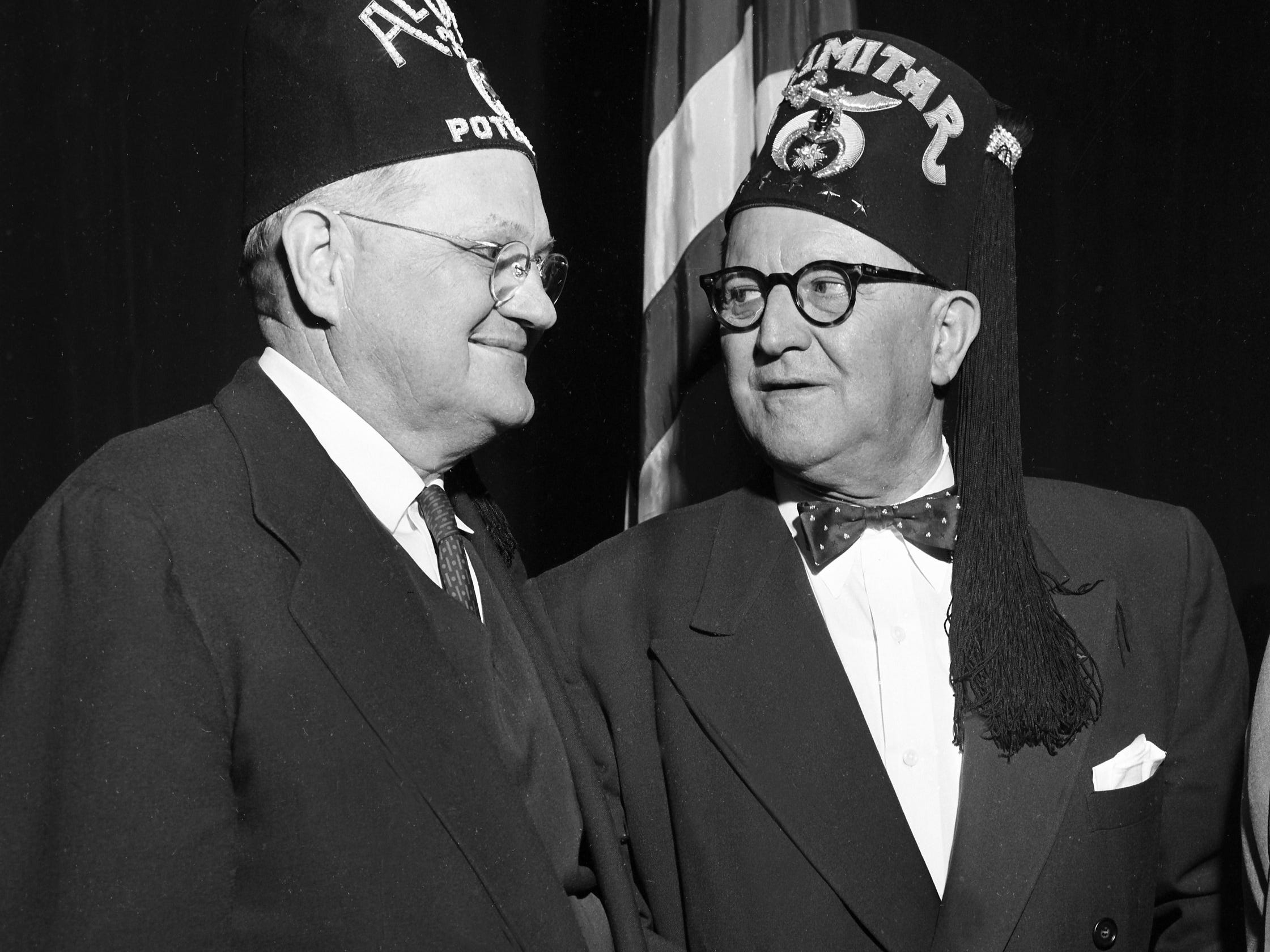 Walter C. Guy (Right) of Little Rock, Imperial Potentate of the Shrine of North America, was welcomed to Memphis in January 1956 by Chalmers Cullins, new potentate of Al Chymia Temple.