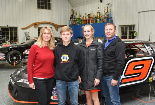 The Kraus family, (from left) Kathy, Derek, Lauren and Mark, pose in the shop where Derek's super-late model race cars are prepared, near their home outside Stratford.