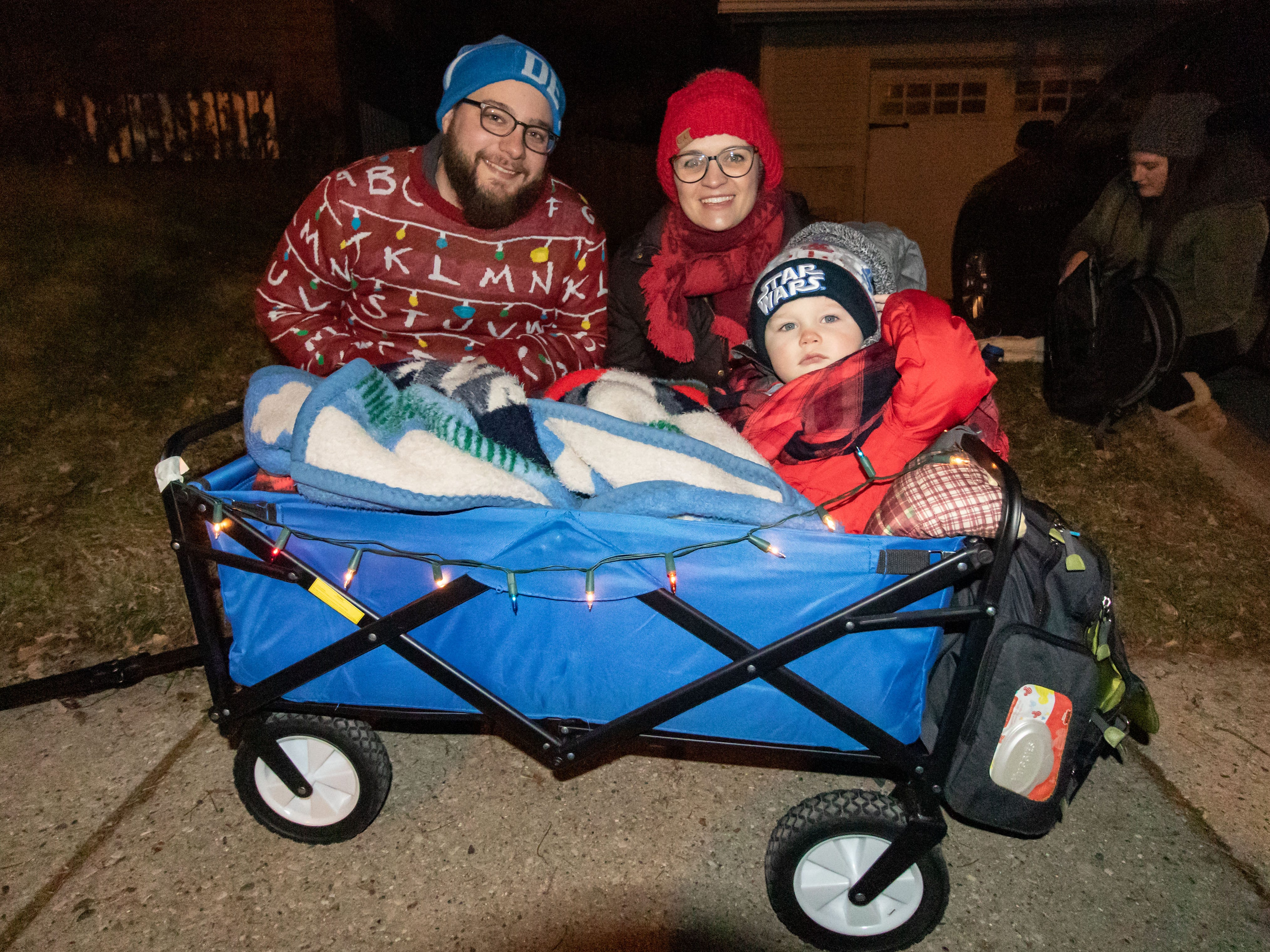 The Kern family from West Allis, Jason, Lisa and two-year-old son Arlo, came ready to sing during Tosa's 7th Annual Christmas Caroling Extravaganza on Saturday, Dec. 22, 2018. The objective of the event is to spread holiday cheer and warm the winter night with song and folly.