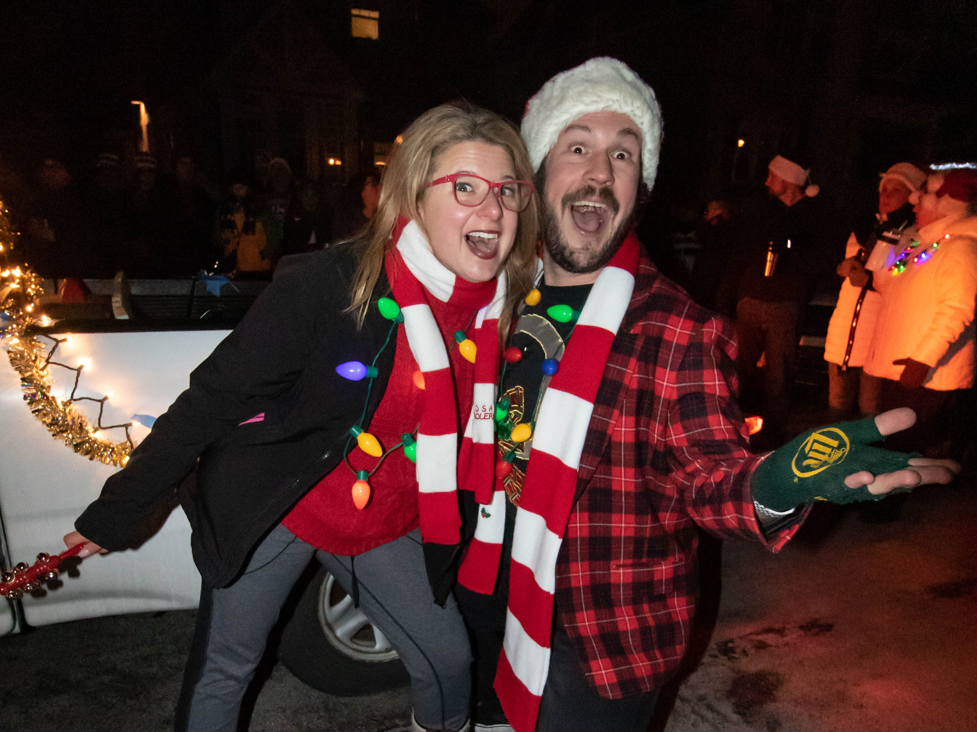 Event organizers Dan and Sherry Wilde lead more than one hundred carolers down 70th St. in Wauwatosa during Tosa's 7th Annual Christmas Caroling Extravaganza on Saturday, Dec. 22, 2018. The objective of the event is to spread holiday cheer and warm the winter night with song and folly.