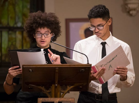 Amber (left) and Mark Davis introduce the music at a Memorial Concert for Milwaukee's Killing of Innocents.