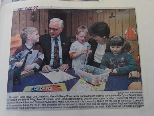 Mountain Home Mayor Joe Dillard visits with Mountain Home Head Start students in this newspaper clipping from 1999. The clipping was part of a scrapbook on display at the mayor's retirement reception on Dec. 7.