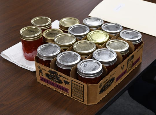 Sixteen jars of strawberry freezer jam sit on a table at the Mountain Home City Council's Dec. 20 meeting. Handing out freezer jam is a long-running  tradition of outgoing Mayor Joe Dillard.
