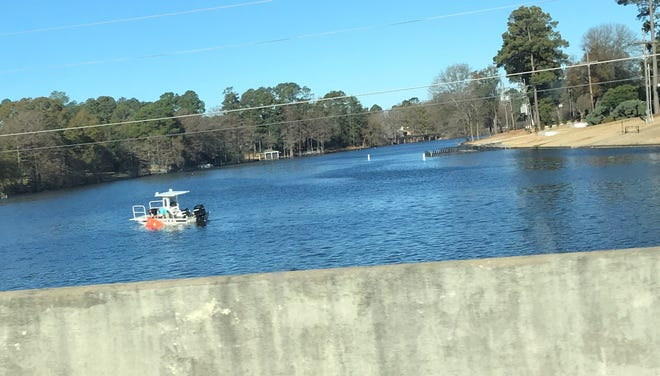 A Monroe Police Department boat pulls a body bag out of Bayou DeSiard around 9:30 a.m. Monday.