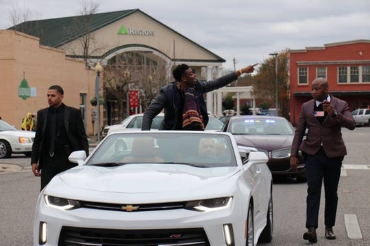 Kirk Jay rides in a parade in his honor Friday in his hometown of Bay Minette.