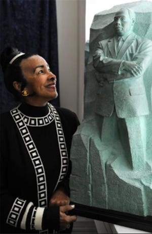 Xernona Clayton looks at a model of the Stone of Hope, the centerpiece of the Martin Luther King Jr. National Memorial Project, in 2008.