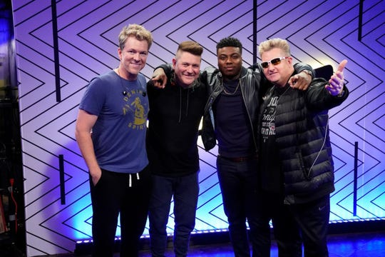"""Kirk Jay poses with the country group Rascal Flatts on Tuesday, Dec. 18, 2018, during the finals results show of """"The Voice."""""""