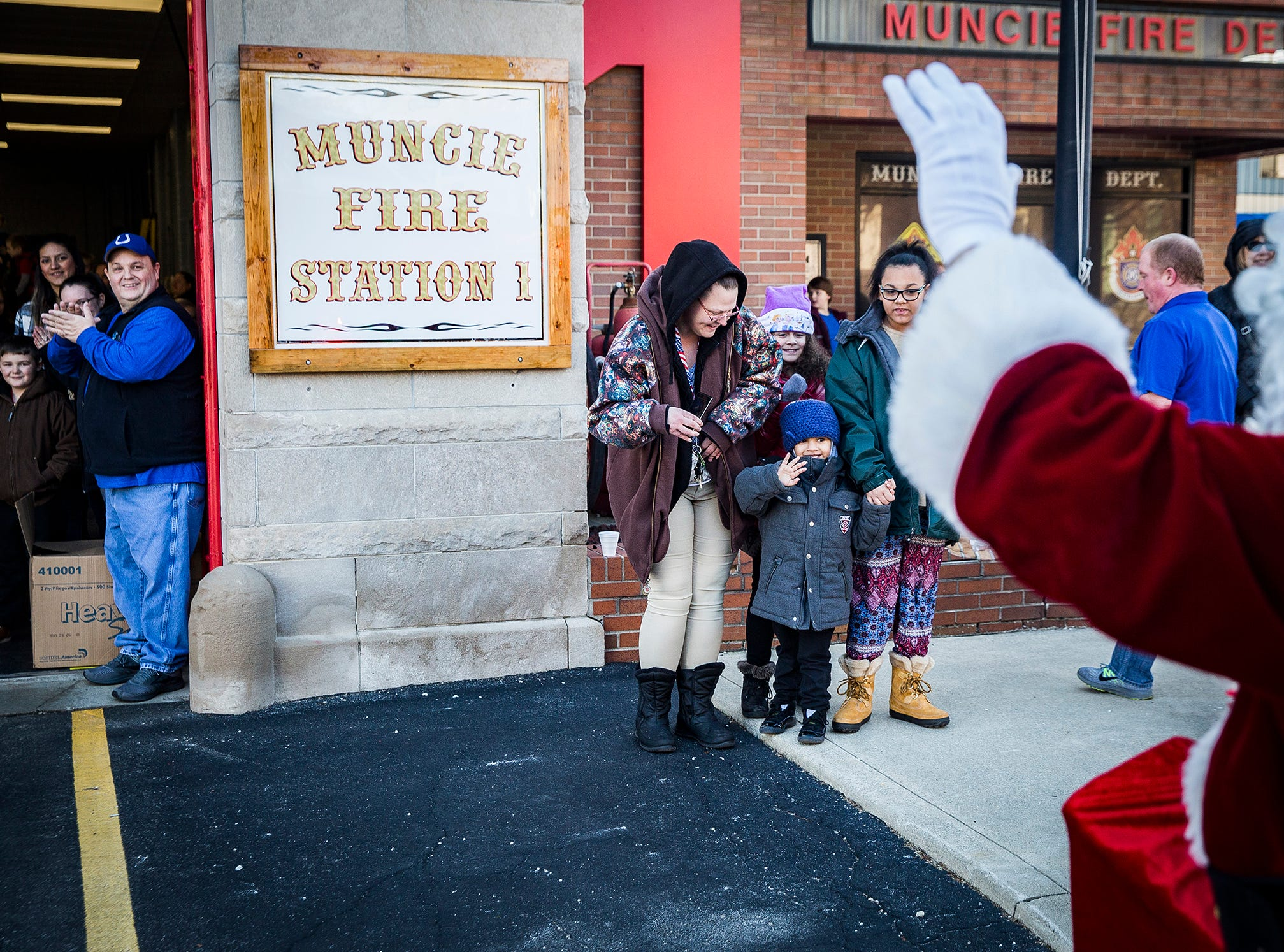 Hundreds of families gathered at Fire Station No.1 in downtown Muncie to meet Santa and receive free gifts Christmas Eve. Firefighters gave away more than sixty bikes during the event.
