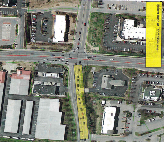 This aerial photograph in yellow shows where crews will add a right-hand turn lane onto Robert Rose Drive for northbound access to Thompson Lane. Robert Rose often gets backed up for commuters between the Stones River Mall area and a Medical Center Parkway area that includes The Avenue Murfreesboro shopping center.