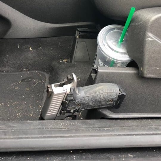 A gun inside a reportedly stolen car.