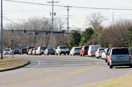 Cars waiting to turn right or go straight at Thompson Lane back up on Robert Rose Drive. The city plans to add a right-turn lane at the intersection.