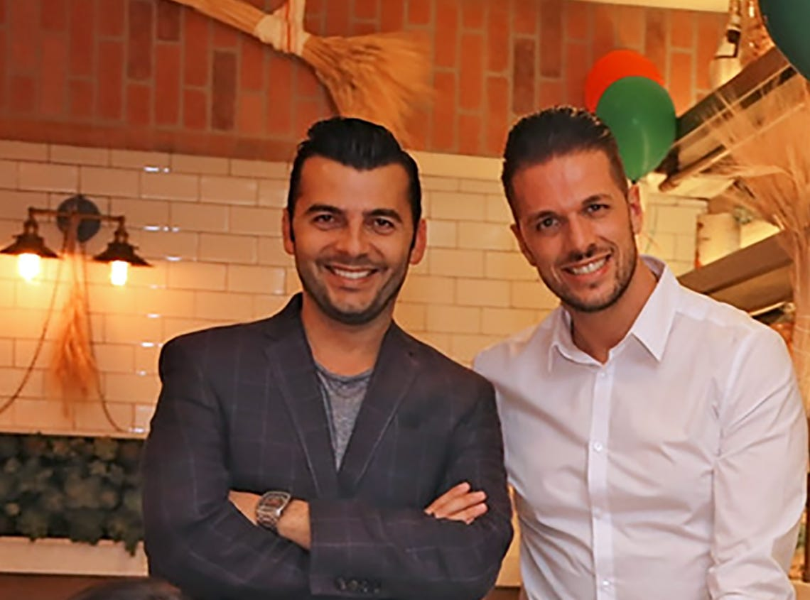 Luca Di Falco, left, and Massimiliano Tonni are behind the new La Trattoria pizzeria on Fifth Avenue South in Naples.