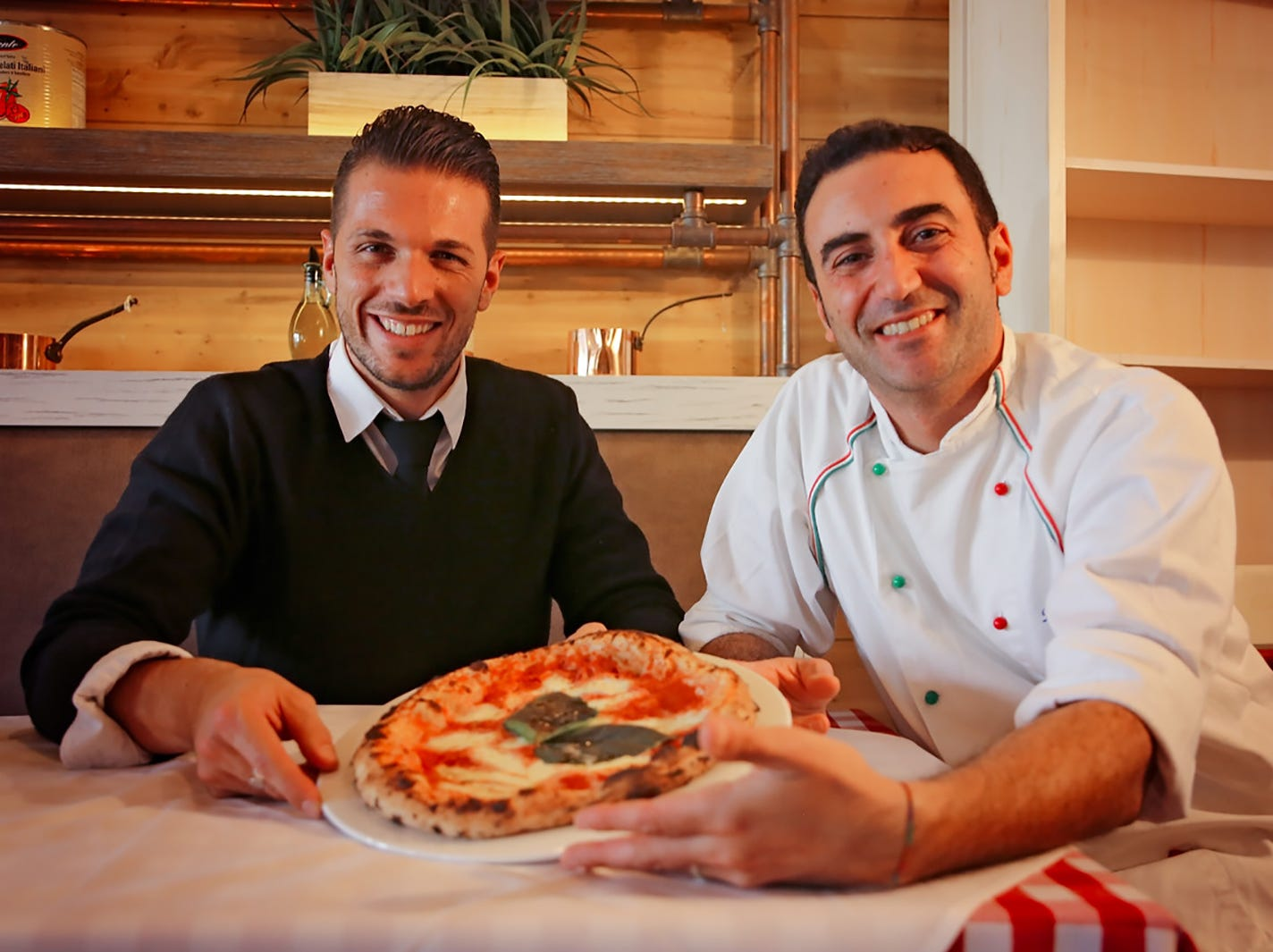 Massimiliano Tonni, left, and Domenico Foraggio are partners in the new La Trattoria on Fifth Avenue South in downtown Naples.