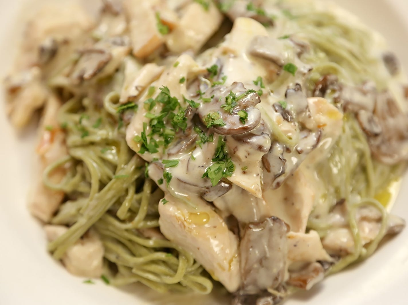 Tagliolini with roasted chicken, mushrooms and a creamy truffle sauce at the new La Trattoria on Fifth Avenue South in downtown Naples.