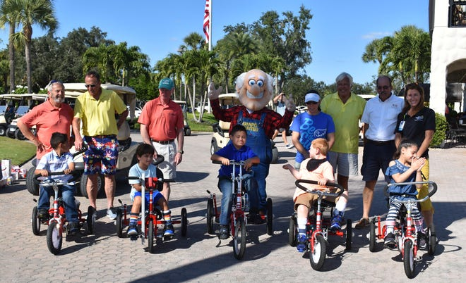 Aaron Zapata, Blake Nawrocki (5-year-old with cerebral palsy), Maximo Zapata (8-year-old with Down syndrome), Garrison Betz (6-year-old with Angelman Syndrome), and Sienna Gonzalez received bicycles or adapted tricycles  from Robbie's Riders, Grampy's Charities and Sanibel Captiva Community Bank on Dec. 18, 2018.