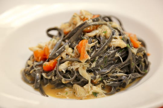 Black ink linguine at the new La Trattoria on Fifth Avenue South in downtown Naples.