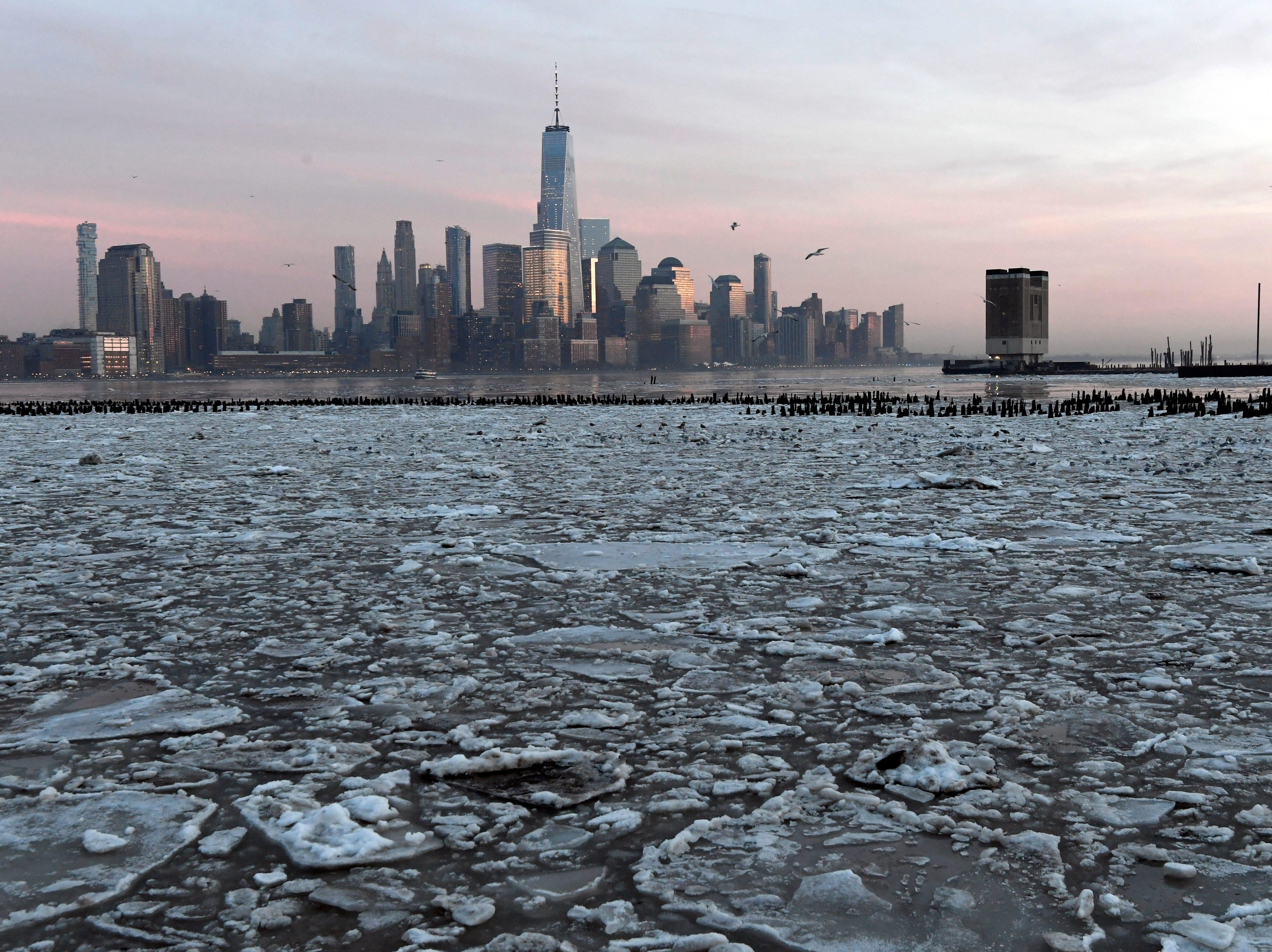 Blocks of ice float in the Hudson River along the Hoboken waterfront, facing the World Trade Center, on Thursday, January 11, 2018.