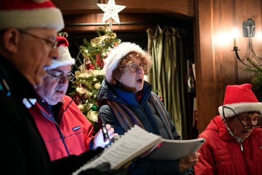 (from left) Patrick Finley, George Dakes, Christine Finley, and Carol Dakes sing carols in a neighbor's home on Sunday, Dec. 23, 2018, in Ho-Ho-Kus.
