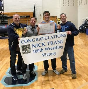 Wayne Valley's Nick Trani (second from right) won his 100th career match at the West Orange tournament. Here he's joined by (from left) athletic director Dave Drozjock, coach Todd Schroeder and assistant Gavin Bannat.