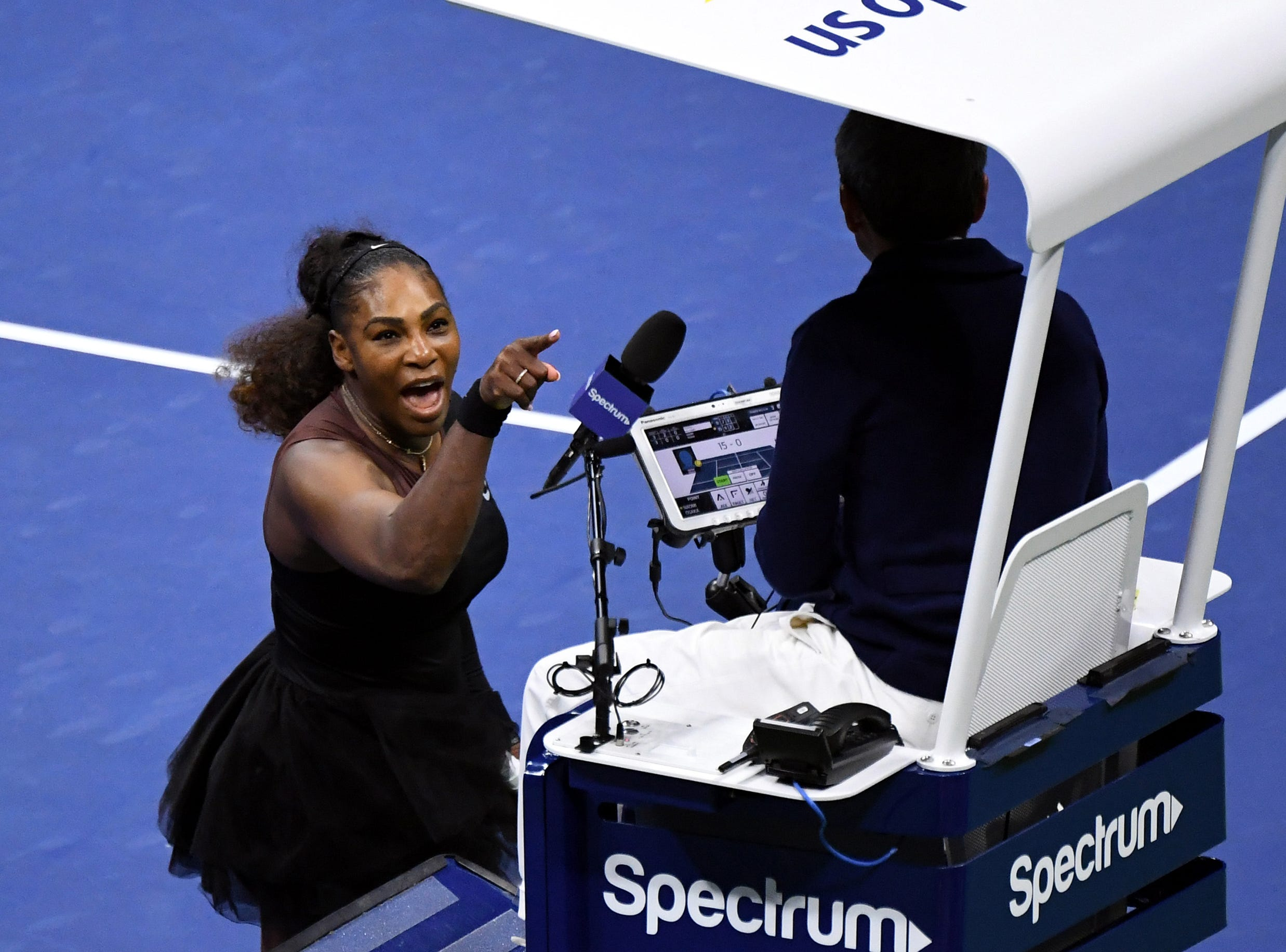 Serena Williams of the United States yells at chair umpire Carlos Ramos in the women's final of the 2018 U.S. Open tennis tournament on September 8, 2018, in New York. Williams was docked a game for the three violations against her in her loss to Naomi Osaka of Japan.