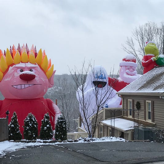 Bloomingdale Nj Christmas Decorations Tower Over Man S House