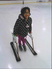 Kateri Sullivan, 14, uses her adaptive walker at Skylands Ice World in Stockholm.