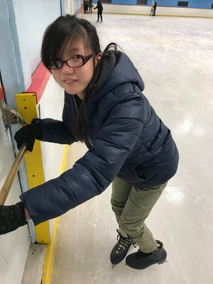 Kateri Sullivan, 14, holds herself up against the wall when not allowed to use her walker at Fritz Dietl Ice Rink in Westwood on Dec. 19, 2018.
