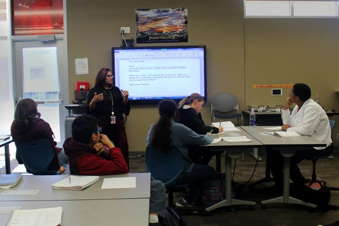 A Las Cruces Public Schools teacher uses a smartboard at Arrowhead Park Early College High School.