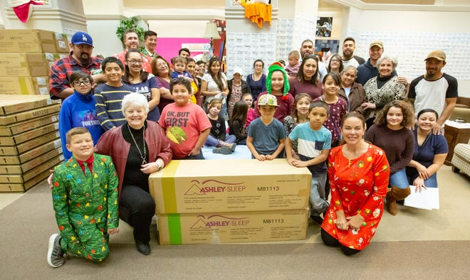 Revolution 120 and Ashley Furniture  HomeStore teamed up to give away 30 new twin-size beds and mattresses on Sunday, Dec. 23, 2018 at the furniture store.