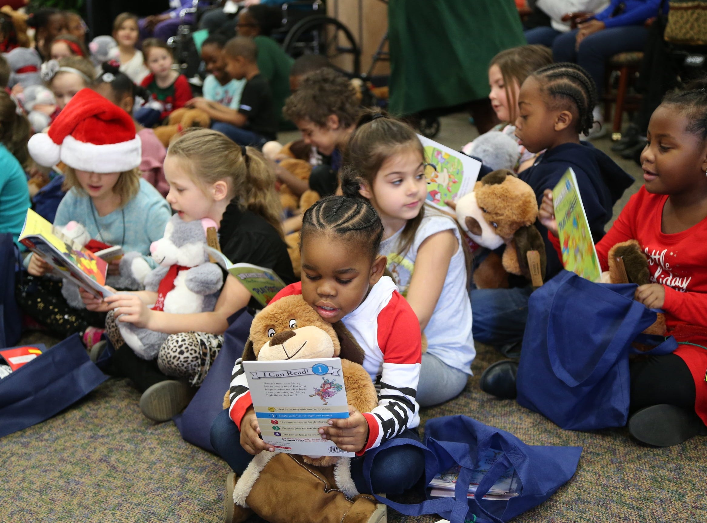 """Before going back to school, students read to their new stuffed animal """"book buddies."""""""