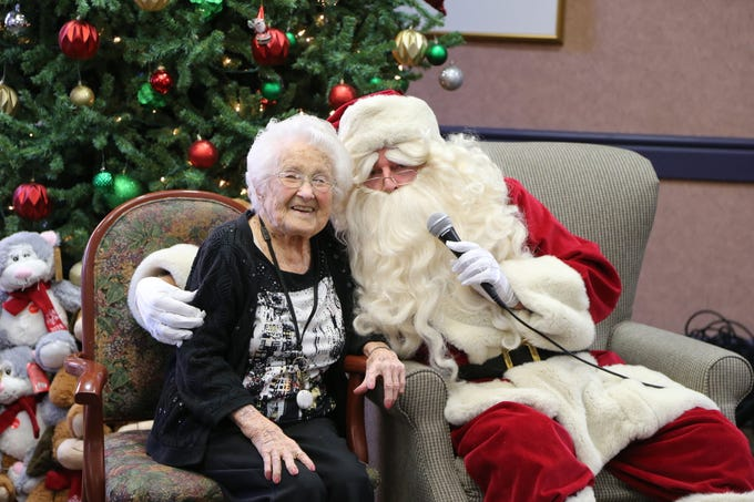 During the Giving Tree event, Santa introduced the children to resident Mary Slucter, a former ballet dancer and teacher who turned 100 years old this year.