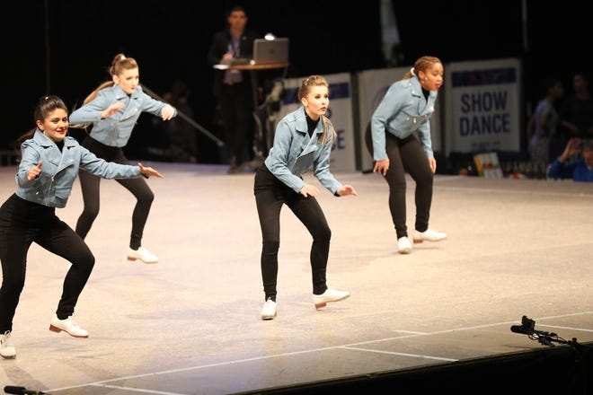 That's South Lyon's Caroline Julian (front, center) performing with the U.S. National Tap Dance Team in Germany.