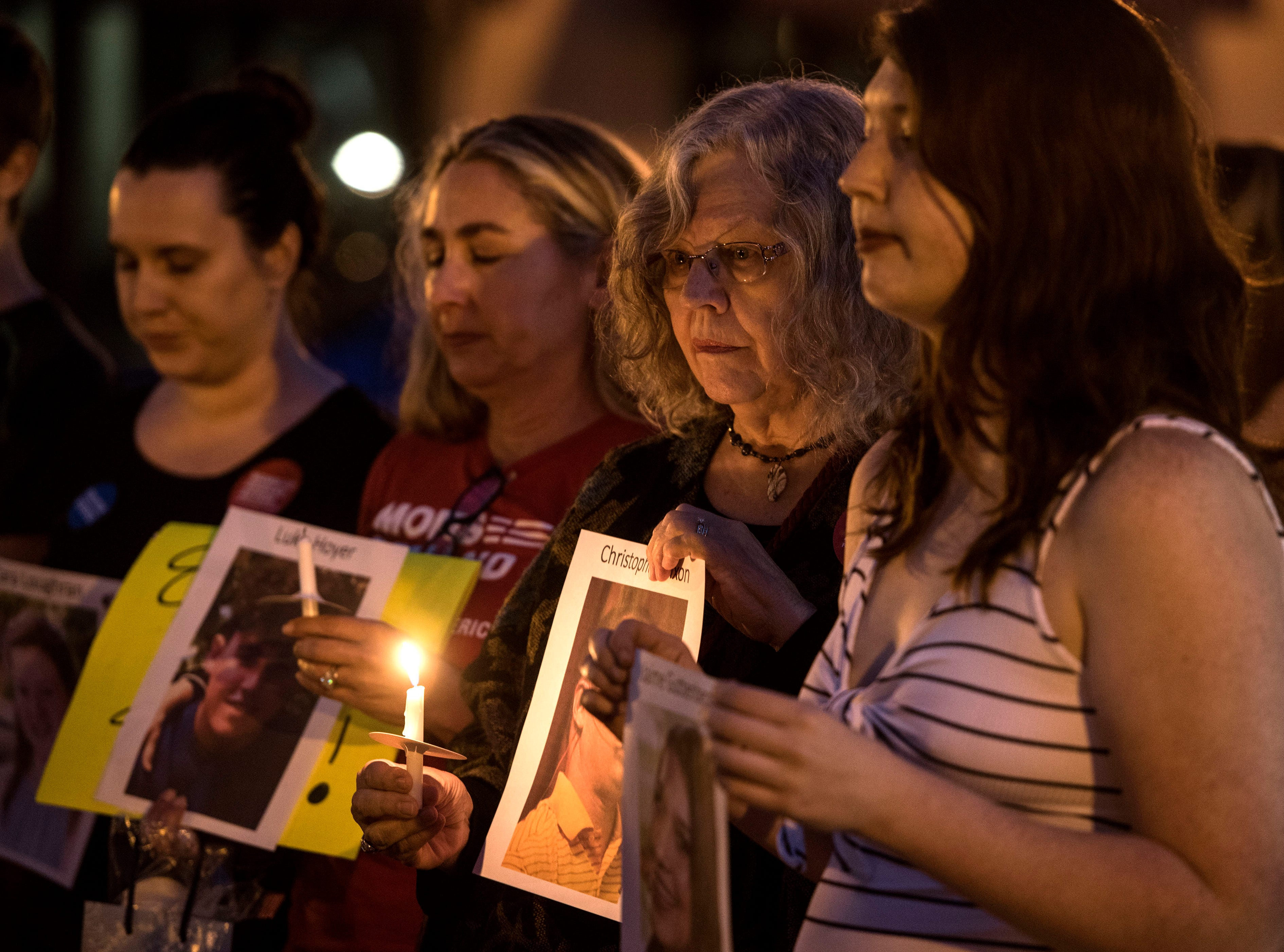 People gather at Garden and Palafox streets Sunday, Feb. 18, 2018, for a  candlelight vigil for Parkland shooting victims. The vigil was hosted by Mom's Demand Action, Indivisible Northwest Florida and Progressives Northwest Florida.