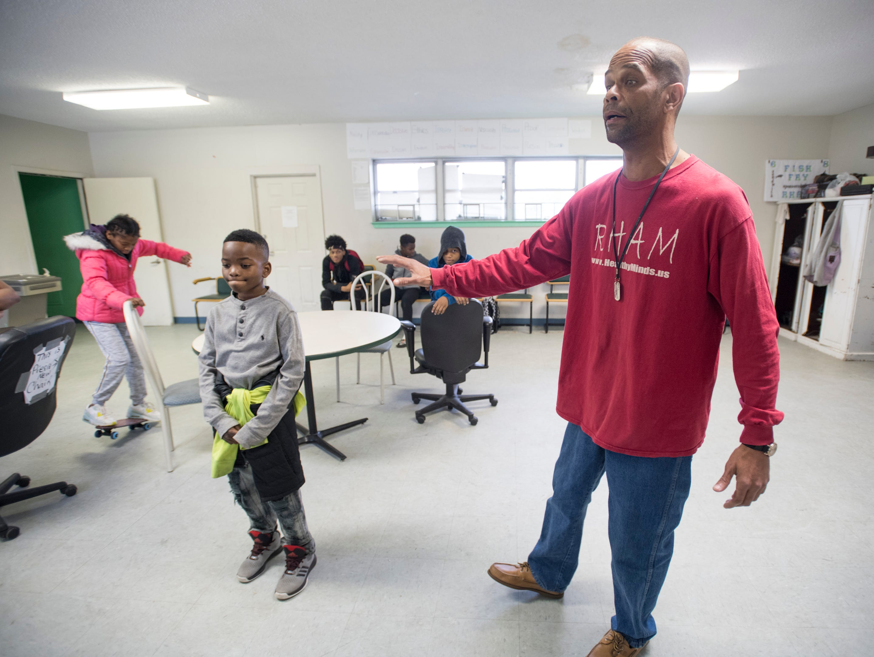 Pierre Robinson, right, talks about his Robinson Harris Academy of Music in Pensacola on Friday, December 21, 2018.