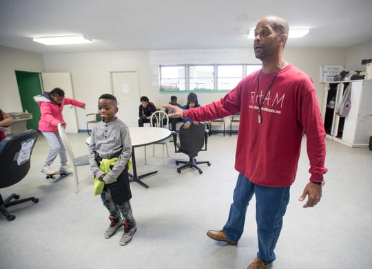 Pierre Robinson, right, talks Friday about his Robinson Harris Academy of Music in Pensacola.