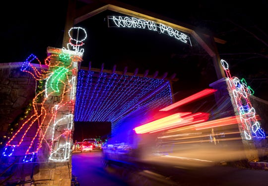 Vehicles drive through the Sowell Farms' North Pole Christmas Light Display in Milton in December 2018.