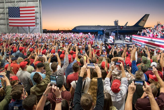 Hundreds of people snap cell phone photos of Air Force One as it pulls up during the Trump rally at the ST Engineering Hanger at the Pensacola International Airport in Pensacola on Saturday, November 3, 2018.  You have to love modern technology!  I love the sea of hundreds of cell phones all snapping away.