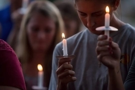 SORROW: About 100 people attend a candlelight vigil for Stormie Harrell, 7, and her sister, Sidney Michaela Dowdy, 17, in front of Alyssa's Antique Depot in Pace on Monday, May 14, 2018. The sisters were killed when a suspected DUI driver hit the car their mother, Melanie Harrell, was driving on May 6. A few months after the crash, the driver who hit them, Kailen Kelly, pleaded guilty to multiple charges and was sentenced to life in prison.