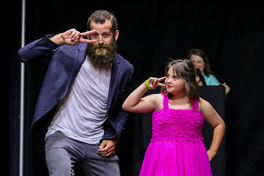 FEARLESS: Lilly Matt, 9, who is battling brain cancer, is fearless as she makes her way down the runway with Joe Hawley, former center for the Tampa Bay Buccaneers and Atlanta Falcons, during the sold-out inaugural Rally on the Runway charity fundraiser event for Rally Pensacola at the Sanders Beach-Corinne Jones Resource Center on Thursday, April 26, 2018. The Rally Foundation helps raise awareness and money for childhood cancer research.