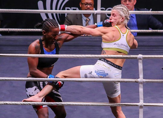 SIMULTANEOUSLY: Vanessa Grimes, left, and Hannah Goldy punch each other simultaneously during Island Fights 46 at the Pensacola Bay Center on Thursday, Feb. 8, 2018. Goldy won by TKO in the second round.