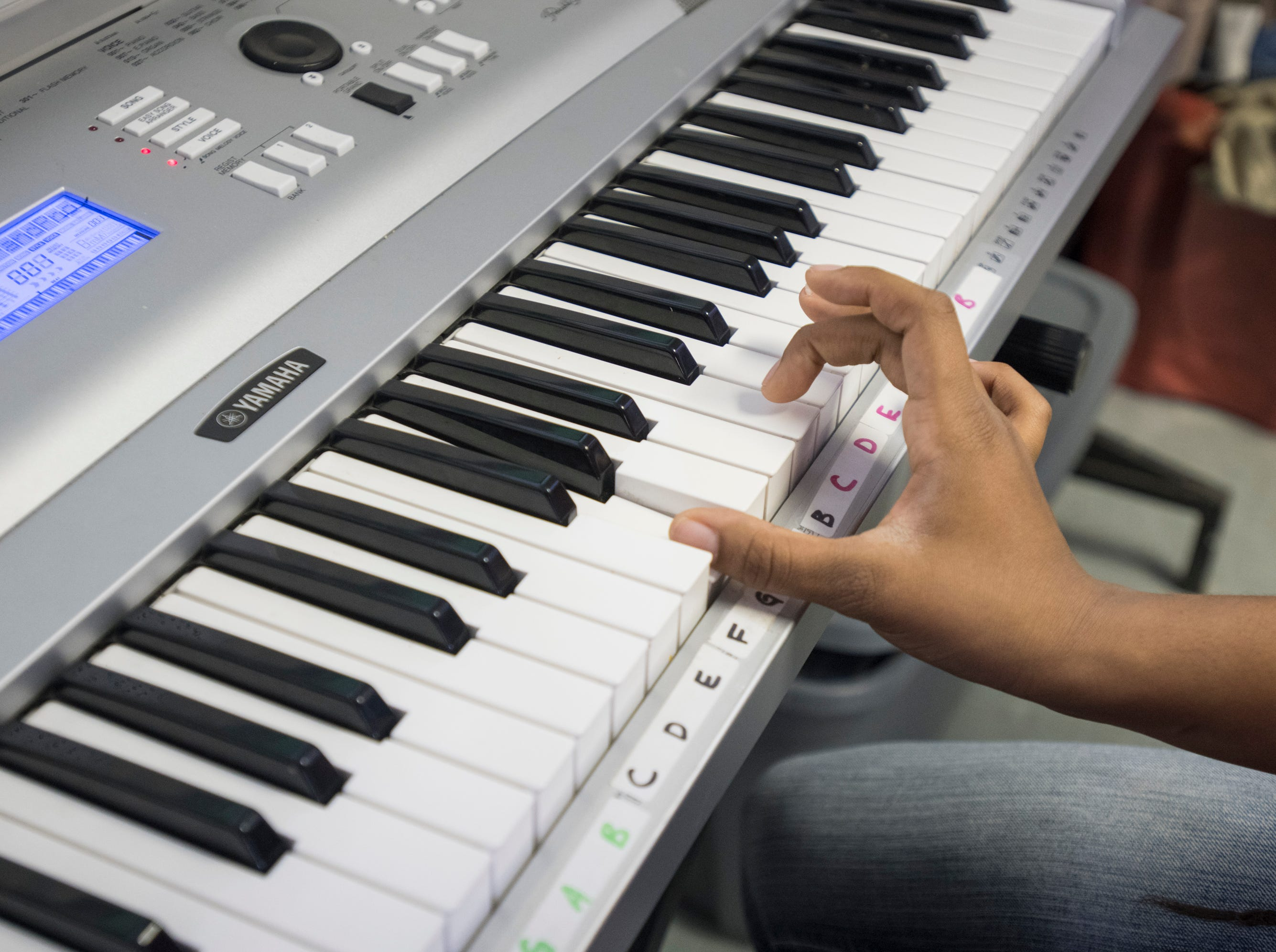 Unique Rigsby-Mack, 11, practices the piano at the Robinson Harris Academy of Music in Pensacola on Friday, December 21, 2018.