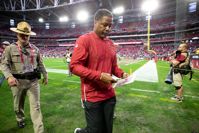 Cardinals head coach Steve Wilks walks off the field after the Cardinals 31-9 loss to the Rams during the NFL game at State Farm Stadium in Glendale on Sunday, December 23, 2018.