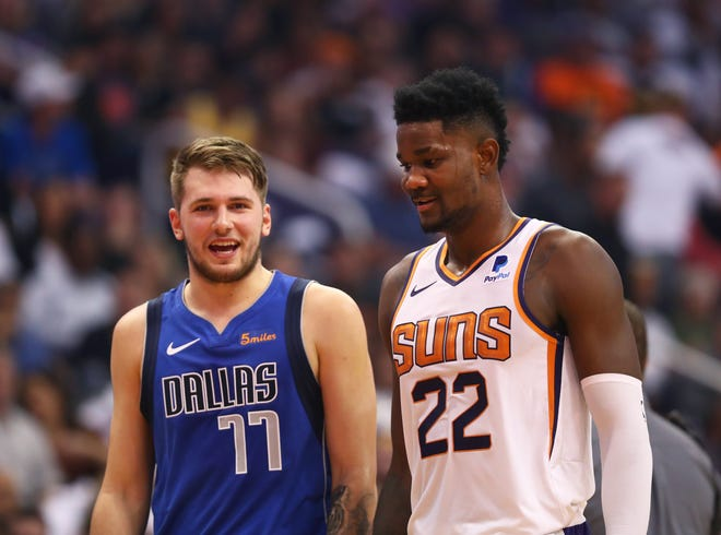 Rookies Luka Doncic and Deandre Ayton  talk during a break in play Oct. 17 at Talking Stick Resort Arena.