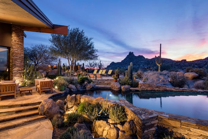 Terrence A. Larsen purchased this mansion in North Scottsdale for $4.5M.  The estate sits above the 17th fairway of the Estancia Club golf course.